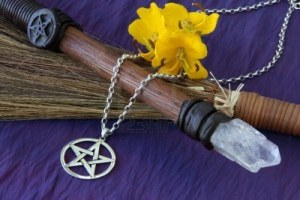 3335545-close-up-of-wiccan-objects--pentacle-pendant-wood--crystal-wand-and-straw-besom
